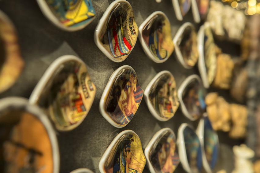 Souvenir Shop Souvenirs/Gift Shop Abundance Art And Craft Choice Circle Close-up Design Egyptian Art Egyptian Culture Egyptian Museum Egyptian Souvenir For Sale In A Row Indoors  Large Group Of Objects No People Retail  Selective Focus Shape Shopping Side By Side Souvenir Souvenirs From Egypt Still Life Store Variation