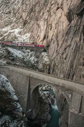 Bridge over rocks against mountains