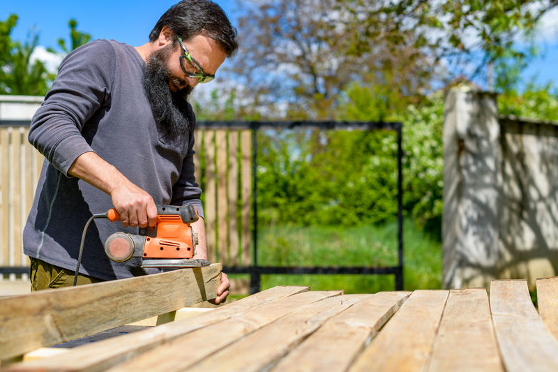 Low angel view of carpenter working outdoors