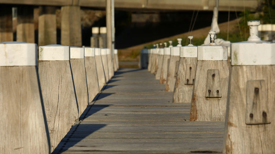 Landing stage in line Focus On Foreground In A Row In Straight Line Landing Stage Lines And Shapes Path Wood - Material