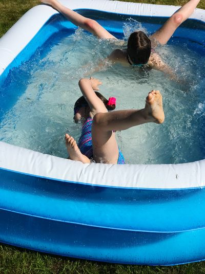 Siblings Swimming In Wading Pool
