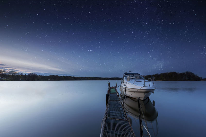Nightphotography Romantic Astronomy Beauty In Nature Clear Sky Constellation Galaxy Lake Milky Way Nature Nautical Vessel Night No People Outdoors Scenics Ship Sky Skyscraper Space Star - Space Star Field Tranquil Scene Tranquility Universe Water
