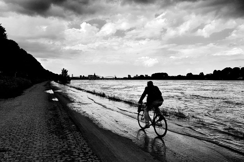 Thrillseeker in the Flood at the river Rhein. Flooding Water Cycling Bnw Bnw_collection Blackandwhite Black And White Black & White Black&white Blackandwhite Photography Monochrome Fortheloveofblackandwhite EyeEm Best Shots Exceptional Photographs Ladyphotographerofthemonth EyeEm Gallery Eye4photography  Silhouette Showcase JuneCloud - Sky Cloudporn Clouds And Sky