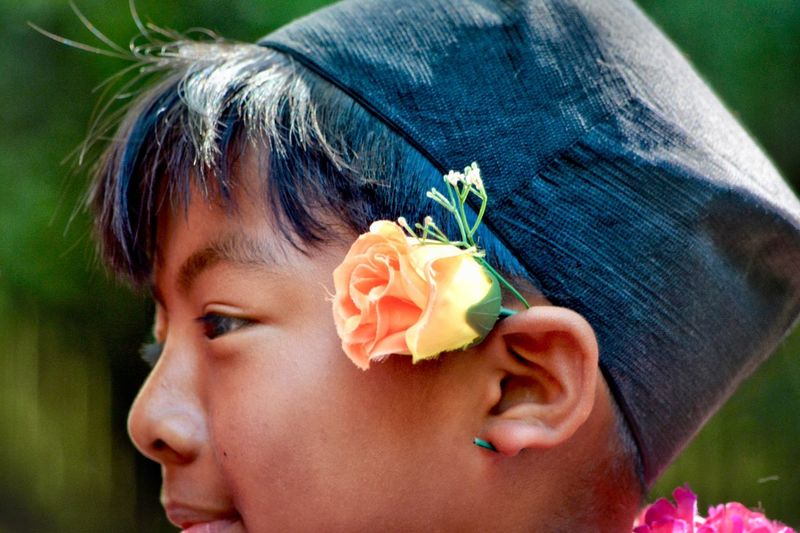 The portraits of this young boy were taken during the festival of Nepal in the big pagoda of Vincennes (France). This young boy participated at Kumari célébration. A silent complicity was established between him and me during which I was able to capture his beautiful expressions of child both candid and malicious. Candid Nepalese Young Boy Portrait EyeEm Selects Flower Flowering Plant Plant Headshot Portrait One Person Close-up Real People Rose - Flower Rosé Day Outdoors Wearing Flowers Flower Head The Portraitist - 2018 EyeEm Awards