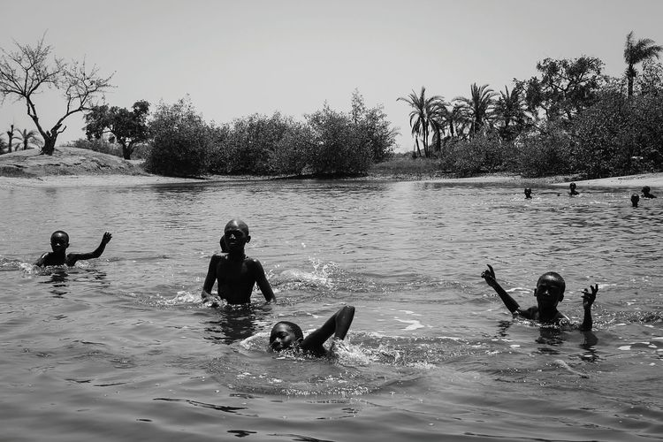 Water People Sunnyday🌞 Children Enjoying MakasutuTree Gambia, Africa People Together Clear Sky Lake Togetherness Motion Fun Summer Nature Sand Outdoors Friendship Dog Swimming Day Swimming Pool Athlete Connected By Travel Lake