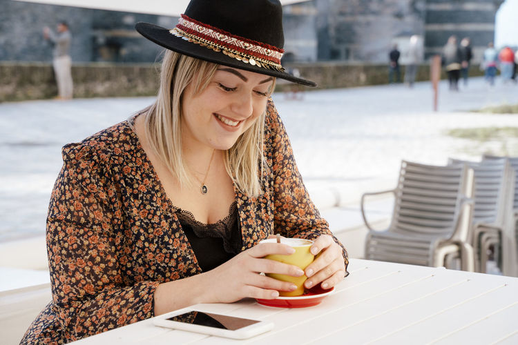 Woman having drink at cafe