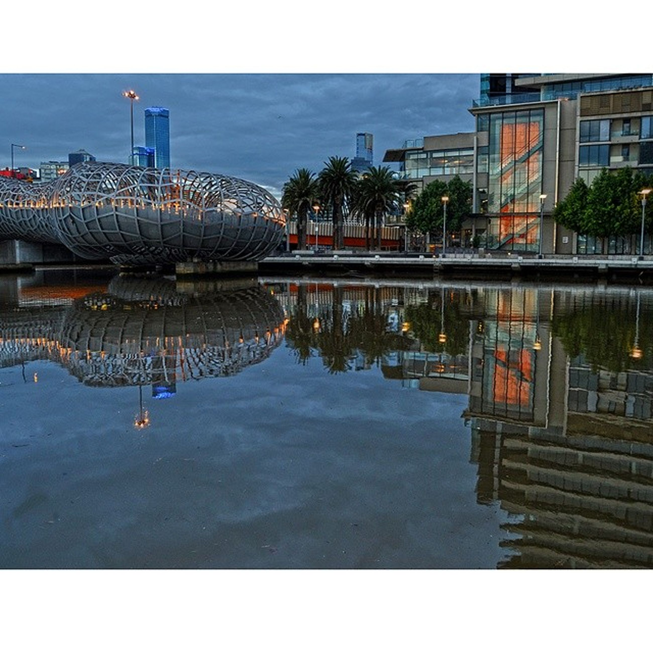 architecture, built structure, building exterior, water, reflection, river, waterfront, city, canal, transfer print, connection, residential building, bridge - man made structure, residential structure, clear sky, railing, building, day, sky, auto post production filter