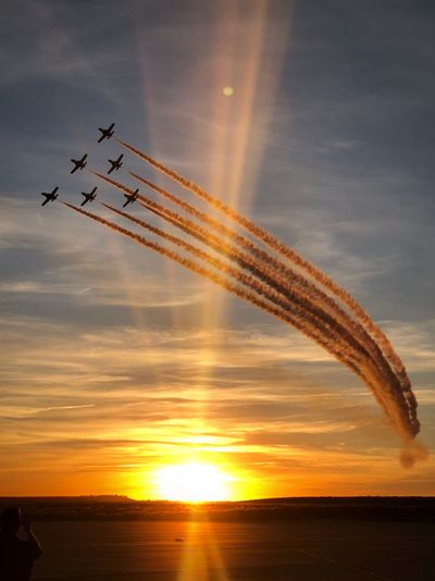 Spain is amazing Sunshine Festa Al Cel Patrulla Aguila Cloud - Sky Air Vehicle Sunset Motion on the move Airshow Flying Speed Orange Color Fighter Plane EyeEmNewHere