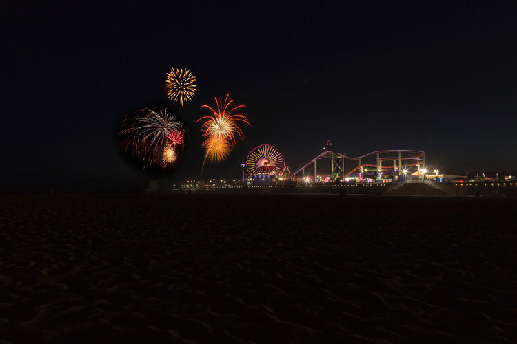 Santa Monica, CA, USA - July 4, 2017: Colorful fireworks over Santa Monica Pier along the coast of Southern California. Editorial Use only. Architecture Arts Culture And Entertainment Building Exterior Celebration Celebration City Clear Sky Coastline Landscape Exploding Firework - Man Made Object Firework Display Forth Of July Illuminated Long Exposure Motion Night No People Outdoors Santa Monica Santa Monica Pier Sky
