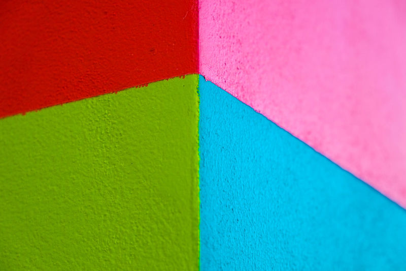 Abstract geometric pattern on concrete wall Art And Craft Equipment Backgrounds Blue Close-up Creativity Flag Full Frame Geometric Shape Green Color High Angle View Indoors  Multi Colored No People Pattern Pink Color Red Shape Textured  Variation Vibrant Color Wall - Building Feature Wood - Material