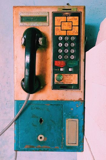 This rare telephones Lagend PhonePhotography Rare EyeEm Selects Technology No People Close-up Number Communication Protection Safety Security Telephone Green Color Metal Connection Old Day Full Frame Outdoors Wall - Building Feature Sunlight Machine Part Electrical Equipment