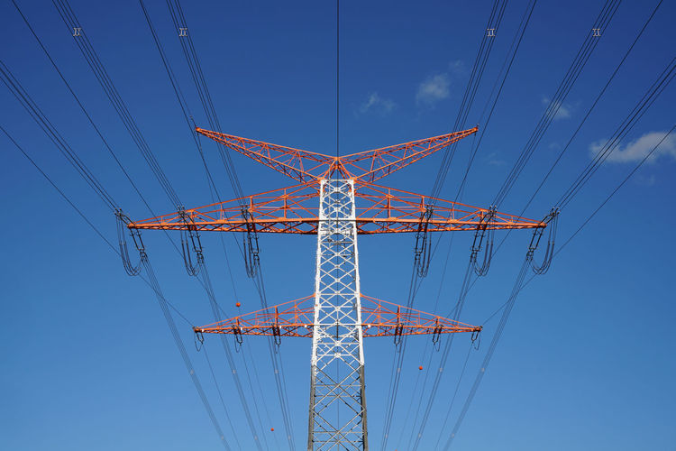 electricity pylon in red and white the sun is shinning and the sky is blue Sky Low Angle View Blue Nature Connection Architecture Cable Electricity Pylon Electricity  Technology Built Structure Metal Power Line  Day Power Supply No People Clear Sky Tall - High Fuel And Power Generation Outdoors Complexity Directly Below Electrical Equipment
