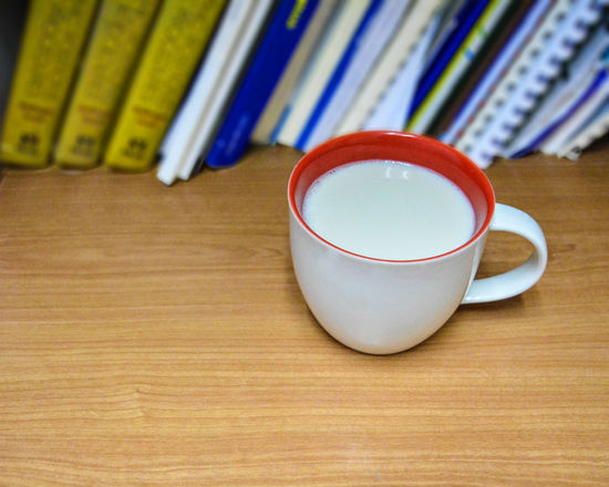 A cup of soy milk in afternoon. Book Cup Drink Food And Drink Refreshment Soy Milk Table Wood Texture