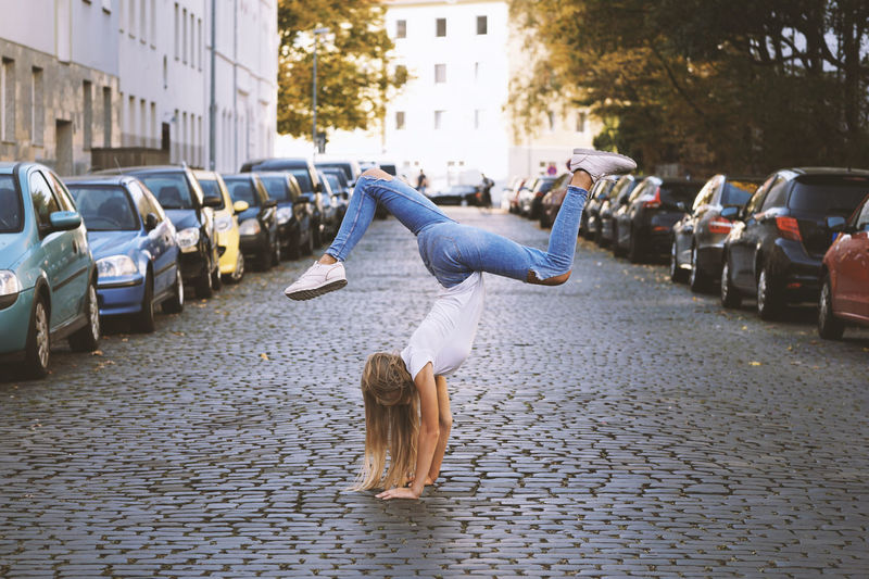 One Person Leisure Activity Day Teenager Girl Blonde Blond Young Women Real People Outdoors City Street Full Length Lifestyles Casual Clothing Handstand  Fun Sporty Sports Urban Lifestyle Youth Carefree