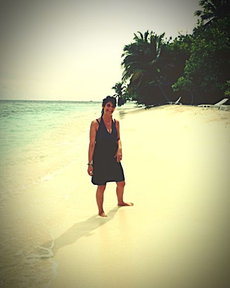 Beach Sea One Person Vacations Portrait Tropical Climate Only Women Sand Outdoors Beauty In Nature Water Beauty