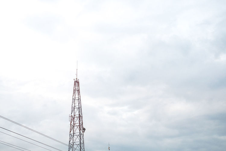 Architecture Beauty In Nature Cable Cloud - Sky Communication Communications Tower Connection Copy Space Heaven Light Breaking Low Angle View Minimal Nature Outdoors Scenics Sky Technology Tower Urban Wires Wires In The Sky Adapted To The City