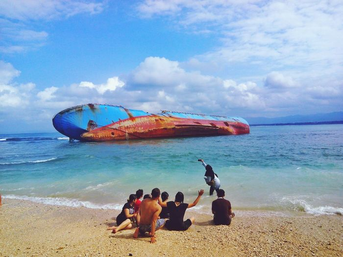 Sea Beach Sand Water Sky Day People Happiness Beach Photography FamilyTime Togetherness Eye Indonesia Traveling Capture The Moment Cloud - Sky Blue Enjoying Life