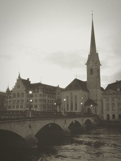 Charming Place Oldtown Blackandwhite Mytravelgram Zürich Church Arts Culture And Entertainment Citylights Travelswitzerland Architecture Business Finance And Industry Bridge - Man Made Structure Built Structure Cityscape Building Exterior Clock Tower River Travel Destinations