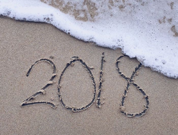 Number 2018 writing on sand about to be wipe out by wave, new year celebration on the beach Wave New Year Beach Land Sand High Angle View Art And Craft Text Creativity Nature Positive Emotion Water Outdoors Day