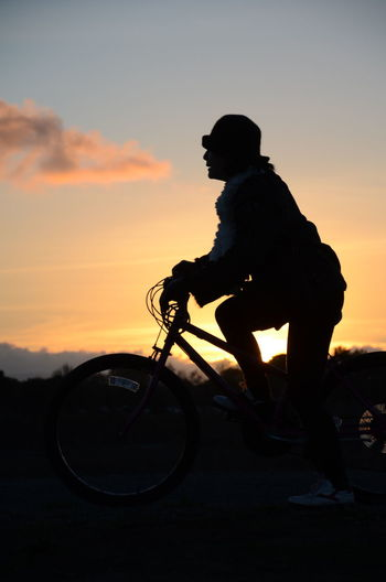 Bicycle Leisure Activity Orange Color Ready To Go Silhouette Starting Step Foreward Sunset Envision The Future The Following Girl Power Feel The Journey