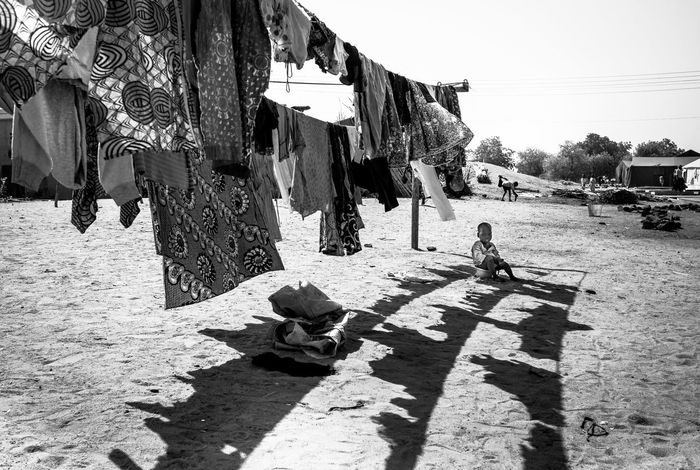 Alone Boko Haram Nigeria Refugee Camp Shade The Week On EyeEm Yola Africa Africa Day To Day Blackandwhite Drying Clothes Eyem Best Shots Heat Monochrome Nowhere To Go Poverty Reportage Sitting In The Shade Terror