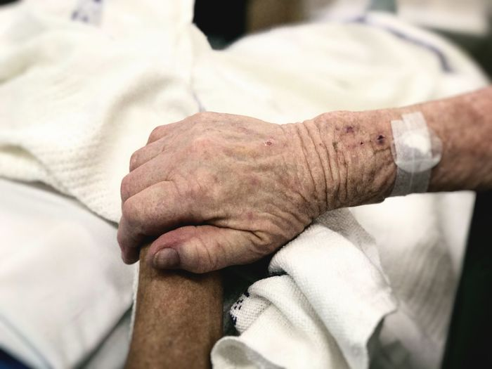 Holding Hands in Hospital Hospital Elderly Holding Hands Hand Human Body Part Real People Close-up Men Focus On Foreground Body Part Healthcare And Medicine Senior Adult Indoors  Adult Lifestyles