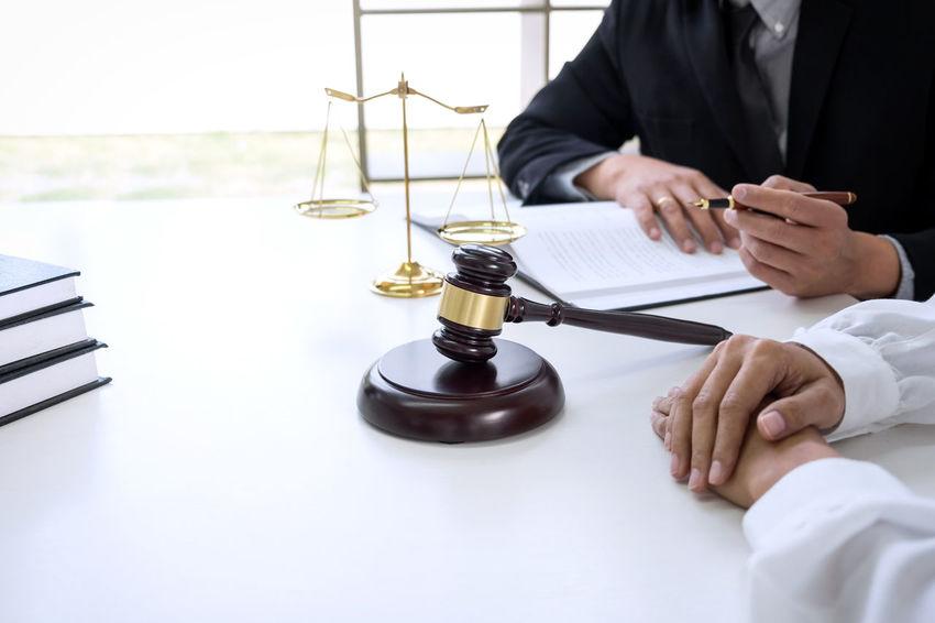 Lawyer Balance Barrister Business Consultant Fairness Gavel Hand Holding Human Body Part Human Hand Indoors  Judge Judgement Justice Legal Legislation Lifestyles Men Occupation Pen Sitting Verdict Women Writing