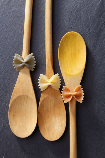 Directly above shot of farfalle pastas on spoons