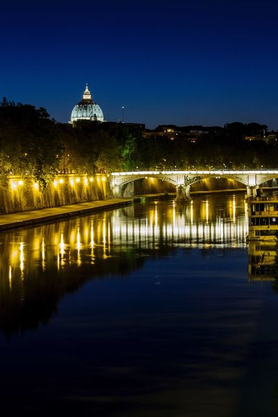Architecture Built Structure Illuminated Night Building Exterior Reflection Water Travel Destinations Place Of Worship Religion Waterfront Dome Spirituality Clear Sky No People Outdoors Sky Nature SanPietro Rome Place Of Heart Your Ticket To Europe Moving Around Rome