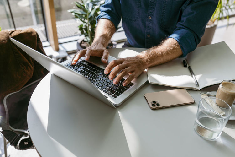 Low angle view of man working on table