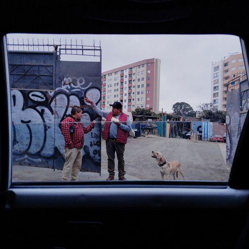 People seen through glass window