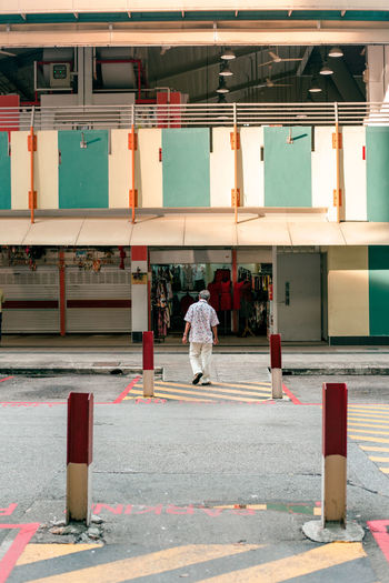 uncle Singapore Old Places Streetphotography Urban Asian City ASIA City Life Portrait Of An Old Man Old Man Elderly Man Architecture And People Rear View City Full Length Rear View Architecture Street Scene City Street Pedestrian Crosswalk