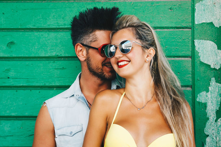 Young Adult Two People Togetherness Young Men Men Couple - Relationship Headshot Young Women Adult Portrait Smiling Real People Love Wall - Building Feature Leisure Activity Emotion Standing Women Positive Emotion Outdoors Beautiful Woman Hairstyle
