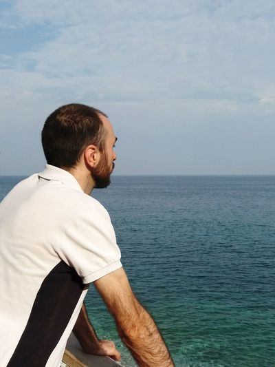 me looking at the sea EyeEm Selects Man Looking At The Sea Horizon Man And Sea Fisherman Seascape Photography Silence Happiness Loneliness Mar Ligure Deep Thoughts Depth Water Sea Men Beard Relaxation Human Back Handsome Standing Seascape Horizon Over Water Rocky Coastline Coastline Calm Wave Ocean Shore Thoughtful Coast