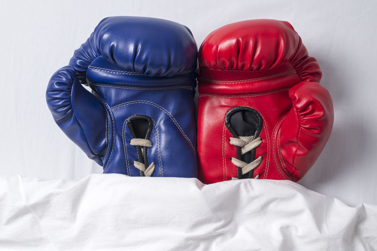 High Angle View Of Boxing Gloves On Bed
