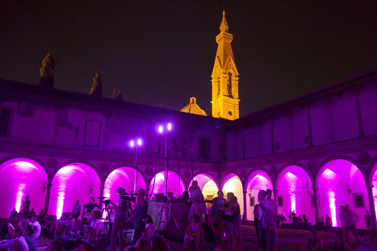 Florence, Santa Croce church and cloister. Arch Architecture Belief Building Building Exterior Built Structure City Crowd Group Of People Illuminated Large Group Of People Night Nightlife Place Of Worship Real People Religion Spirituality Travel Destinations Women