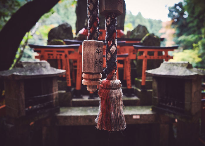 Close-up of bell hanging outside shrine