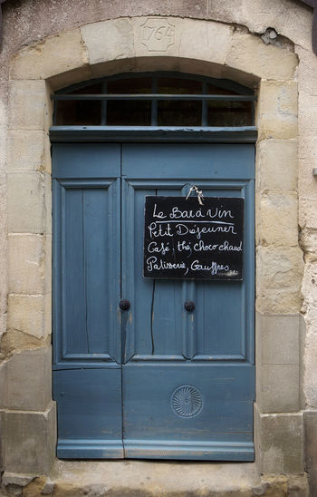 Photo of a Boulangerie Door in Carcassonne, France. Arch Bakery Cafe Blue Door City Street Door France French French Door Historic Old Wall - Building Feature Weathered