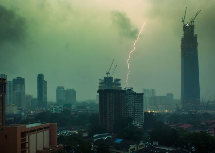 Kuala Lumpur Malaysia  Raining Weather Architecture Awosome Building Exterior Built Structure Centurytower Chillin City Cityscape Clouds And Sky Dehaze Foggy Day Forked Lightning Hazy  Illuminated In Lightning Nature No People Sky Tree