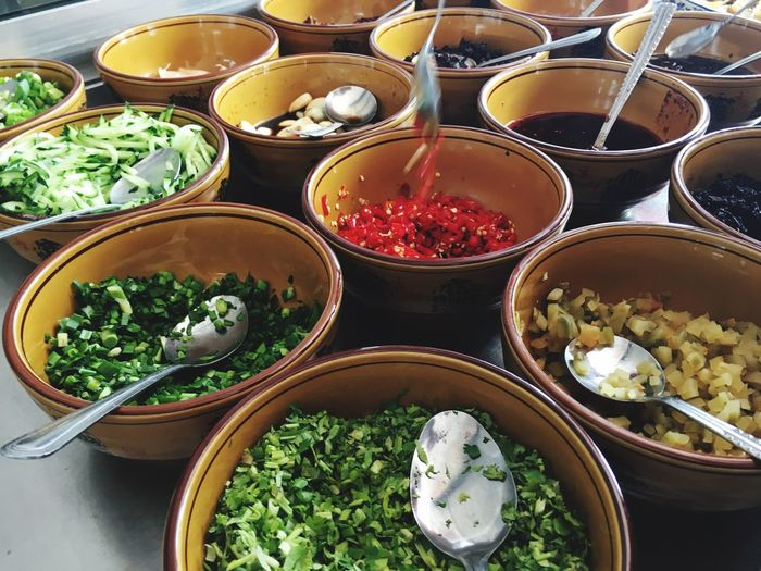 High Angle View Of Food In Bowls On Table
