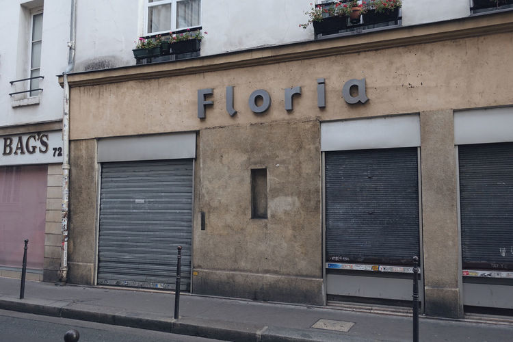 Street Streetphotography City City Life Old Sign Built Structure Architecture Building Exterior No People Day Building Wall - Building Feature Wall Closed Western Script Lifestyles Life Store Old Town Paris France Travel Minimal Text