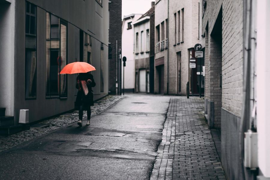 Real People Built Structure Architecture One Person Outdoors Building Exterior City Day Rainy Season Adult People Adults Only Solitude 50mm1.4 50mm Alone City Streets Urban Belgium Europe Umbrella Walking Noface Canon