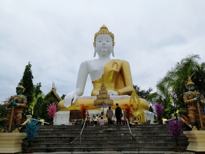 Religion Statue Place Of Worship Travel Destinations Cultures Architecture Sky Outdoors Textured  Vacations Spirituality Statue Travel Landmark Thailand History Place Of Worship Architecture Ancient Pagoda Gold Temple Textured  Development Tourism