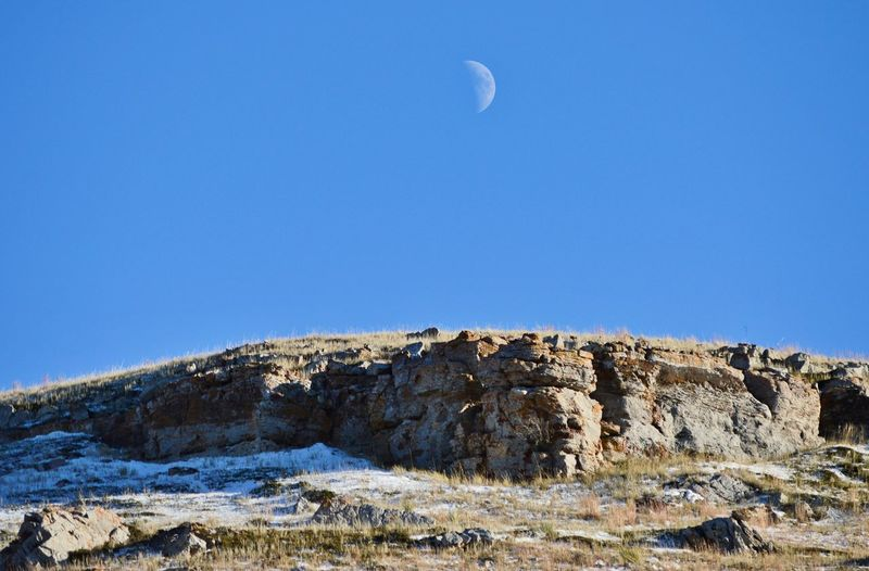 Afternoon view Next To Highway Rock Formation Outdoors Shadows Long Distance Shot Blue Color Pasture Late Evening View From Below Clear Sky Moon Landscape