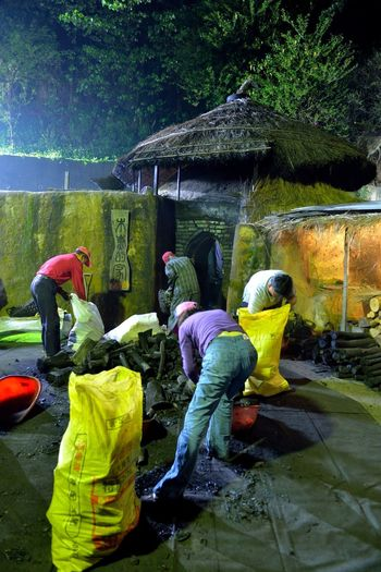 Making kiln-fired charcoal is a traditional handicraft industry. Charcoal Kilns In The Dark Hot Industry Toilet Tradition Black Burn Wood Charcoal Day Economic Full Length Give Kiln Labor Force Men Outdoors Real People Rear View Tree Water Waterfall Women Work Hard
