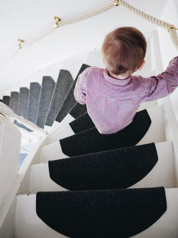 Real People One Person Full Length Indoors  Childhood Lifestyles Day People Wood - Material Staircase Stairs Stairways Step Steps And Staircases Going Downstairs Step By Step Steps And Staircase Kid Child Child Photography