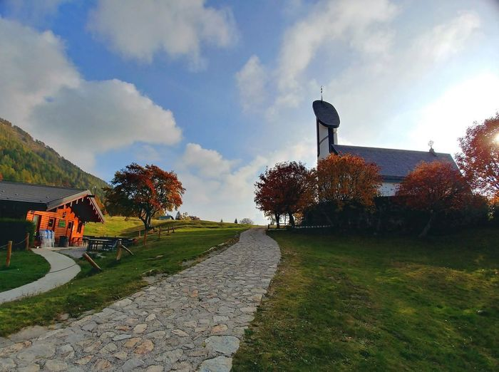 Sky Plant Cloud - Sky Tree Architecture Outdoors No People Land Moutains Mountain View Autumn Autumn colors Nature Built Structure Curch Valsassina Margno Pian Delle Betulle Chiesa Della Madonna Degli Alpini Cereghini Yellow Red Beauty In Nature Tranquility God