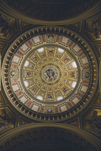 Richly decorated ceiling with painted scenes and gold details. Architecture Art And Craft Belief Building Built Structure Ceiling Circle Creativity Cupola Design Directly Below Dome Indoors  Low Angle View Mural No People Ornate Pattern Place Of Worship Religion Shape Spirituality