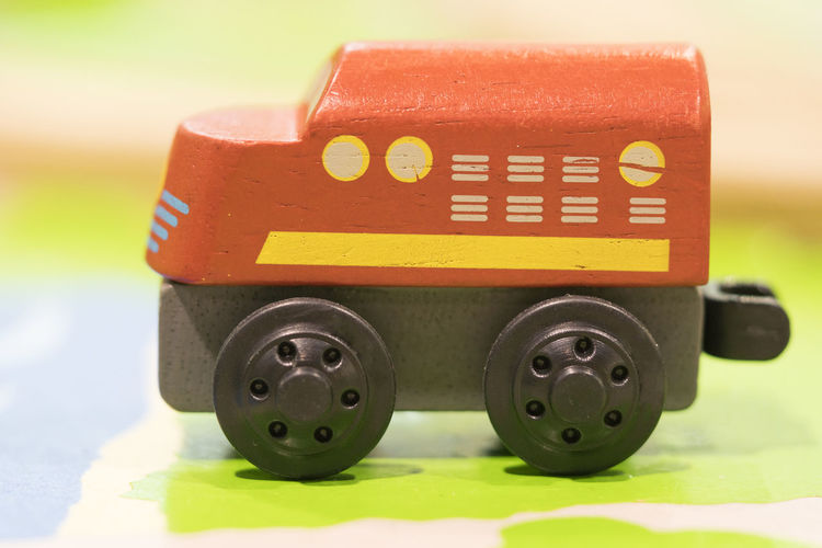 Red train Wooden toy - Toys for kids Play set Educational toys for preschool indoor playground (selective focus) Transportation Close-up No People Yellow Mode Of Transportation Still Life Toy Focus On Foreground Day Wheel Tire Red Text Green Color Indoors  Road Communication Car Wooden Toy Wooden Toy Block Wooden Toy Train