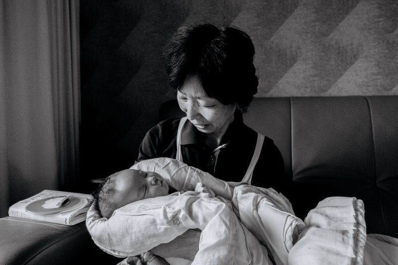 Family Blackandwhite Togetherness Baby Love Bonding Family Indoors  Care Real People Family With One Child Newborn Senior Women Women Childhood Happiness Adult Cheerful Sitting Smiling Human Body Part People
